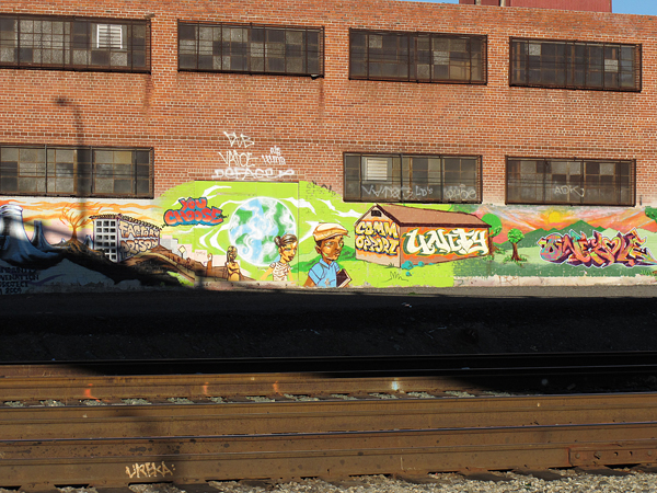 oakland graffiti art, graffiti by train tracks, you choose, opportunity/community, unity