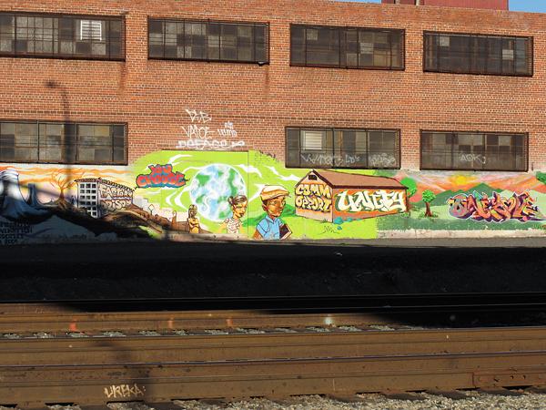 oakland graffiti art, graffiti by train tracks, you choose, opportunity/community, unity