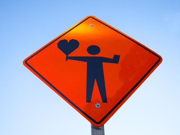altered construction sign, guerilla street art