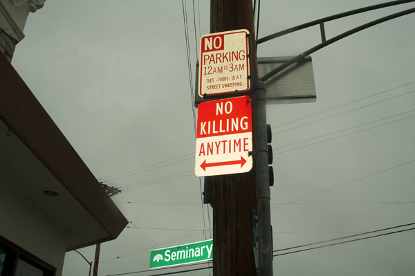 oakland graffiti, no killing signs, modified parking signs
