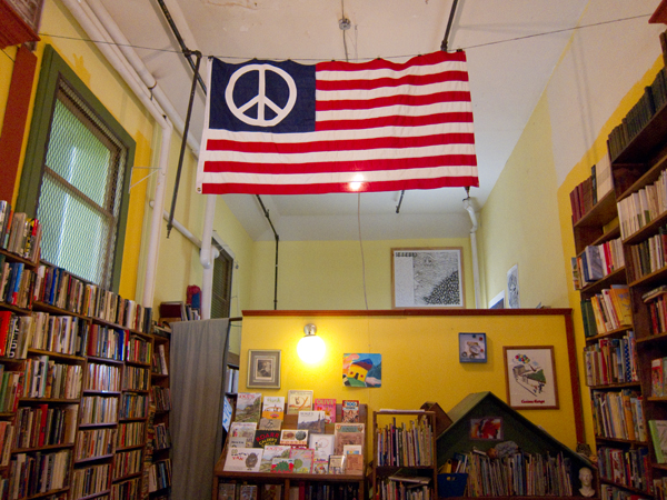 flag with peace symbol, radical politics