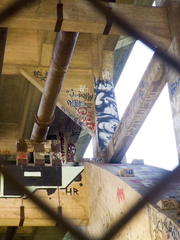 Graffiti Face under bridge