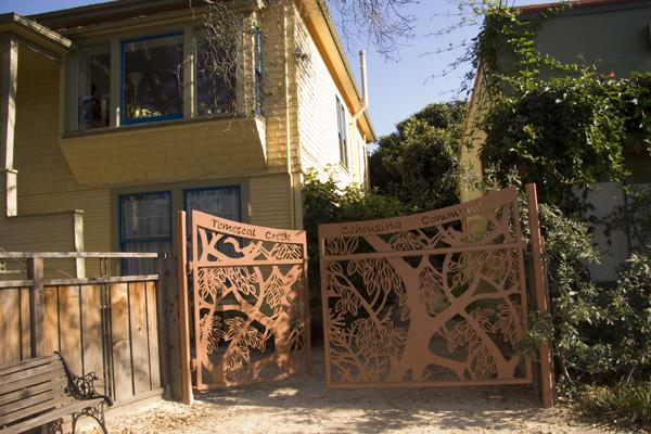 temescal creek cohousing community, metal sculpture gate