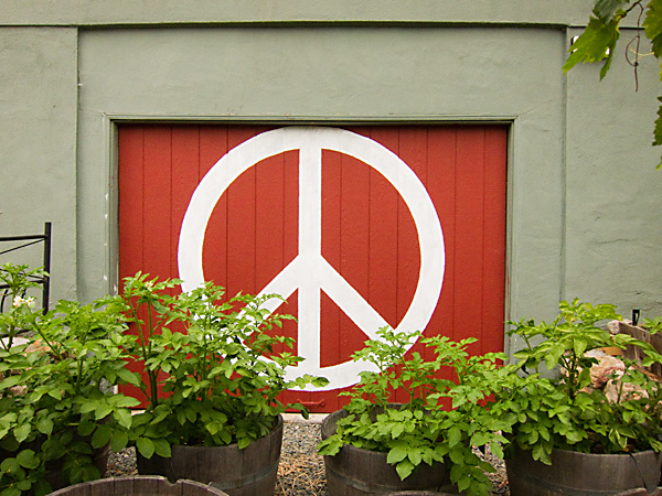 Painted peace sign on garage, peace signs oakland
