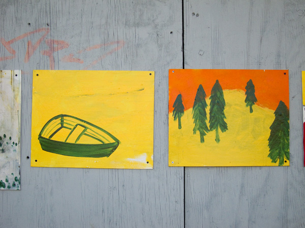 yellow green paintings, painting of boat, painting of trees, guerilla art