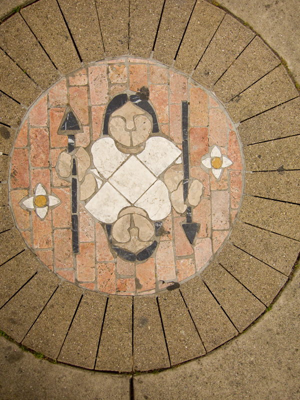 woman with spear, stone mosaics, fruitvale transit village art